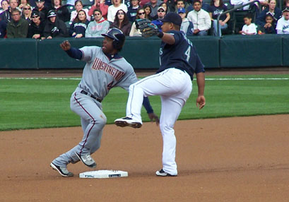 Lastings Milledge pops up at second after a successful steal in the second inning.