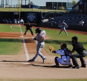 Bryce Harper hits a triple into the gap on November 10 against the Peoria Saguraros